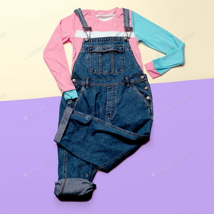 Fashionable denim overalls. Stylish clothes. Urban fashion