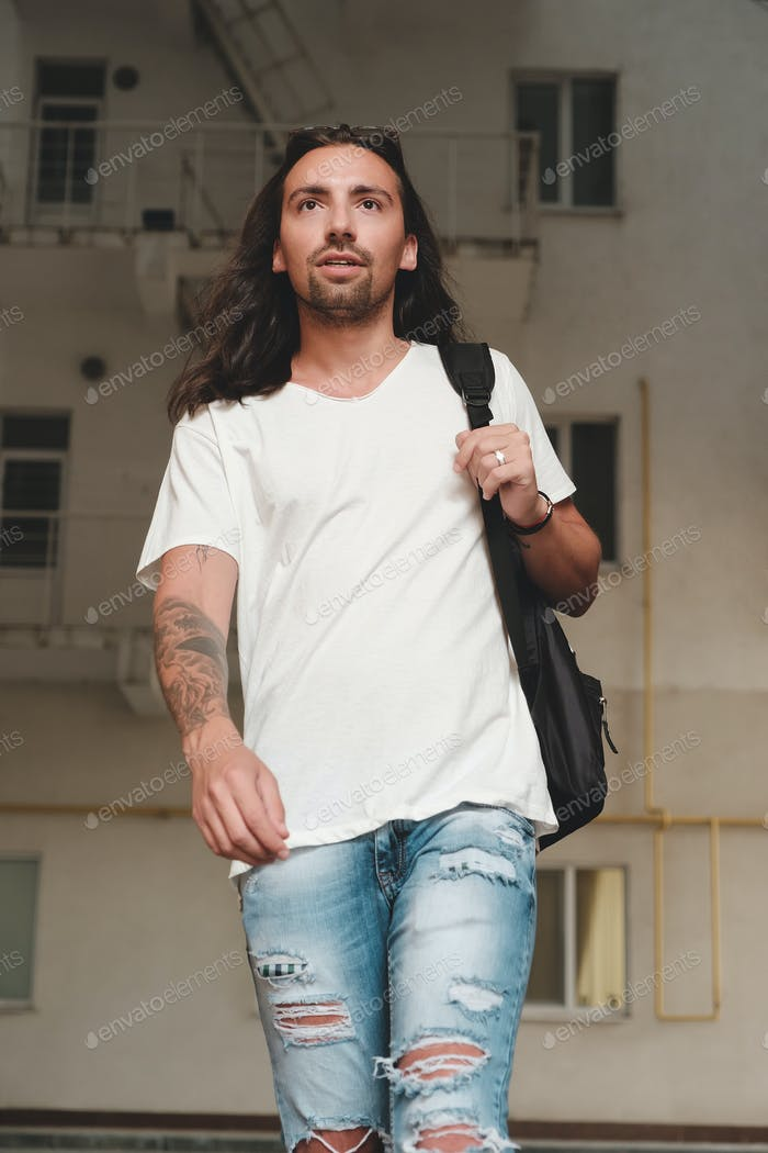 Man on urban background with backpack