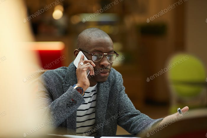 Contemporary African Man Speaking by Phone