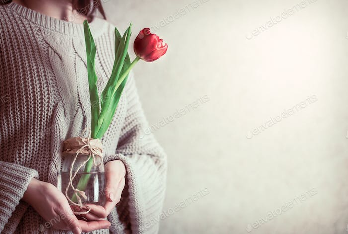 Girl with tulip in hands