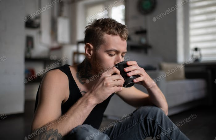 Hipster drinking with closed eyes