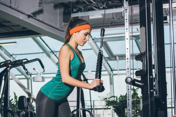 sporty woman training on  training apparatus at gym