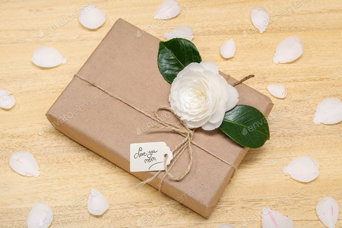 Gift box with label and flower