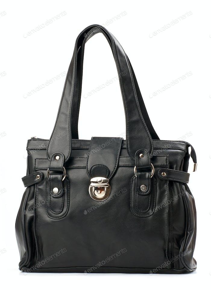 Black female handbag over white