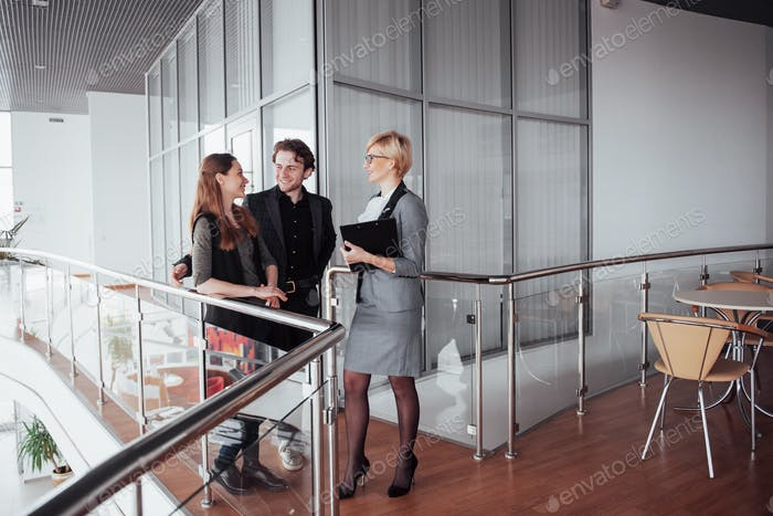 Young male and female coworkers discussing and planning productive working process in office