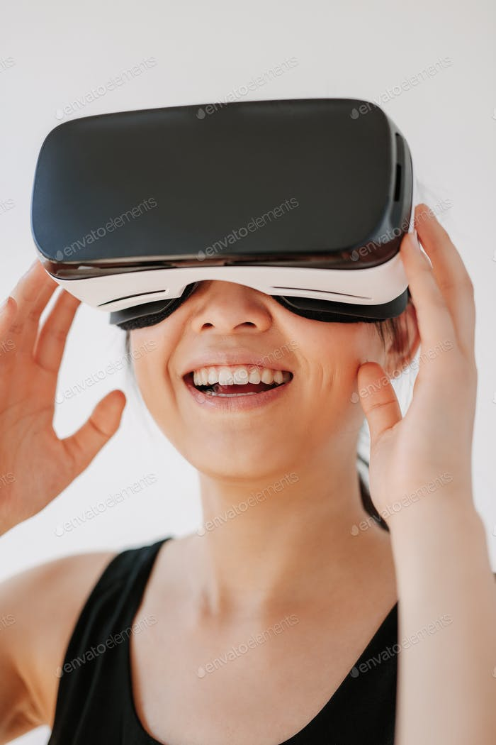 Smiling woman using the VR goggles