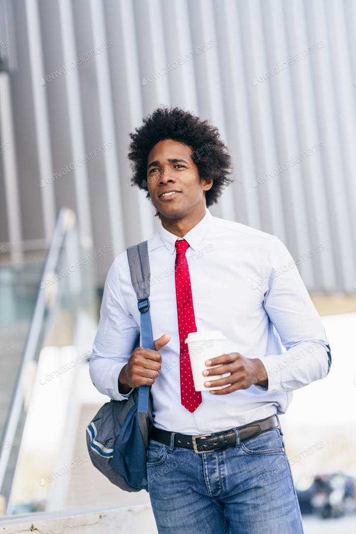 Smiling Black Businessman with a take-away glass