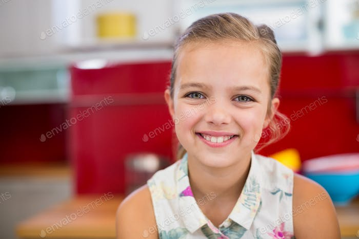 Girl smiling at camera at home