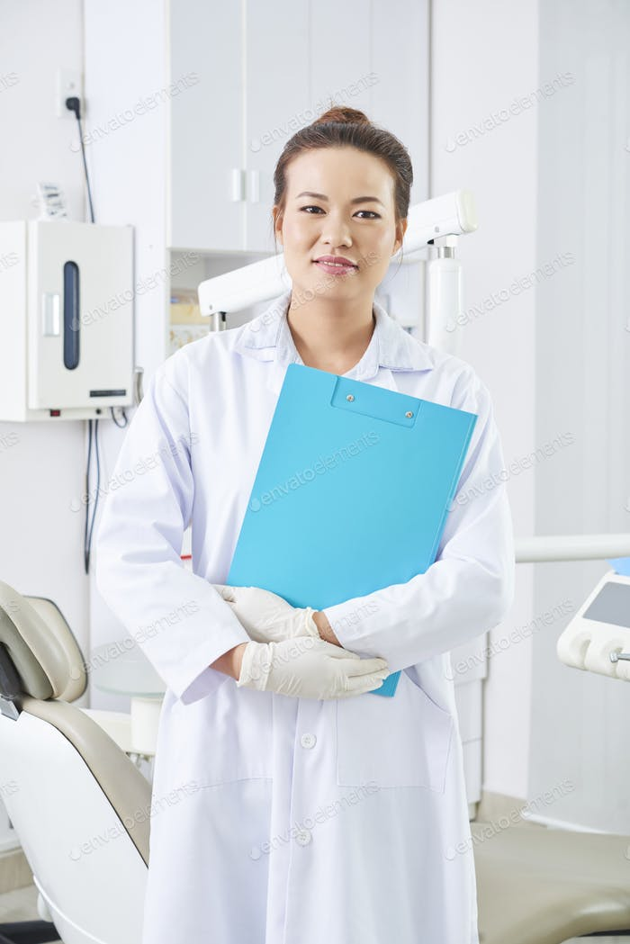 Dentist Holding Blue Clipboard