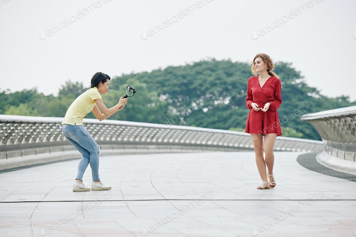 Woman filming walking blogger