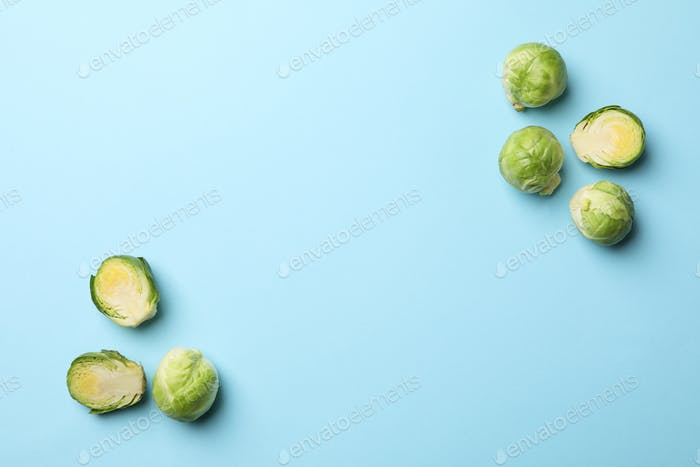 Brussels sprout on blue background, top view and space for text