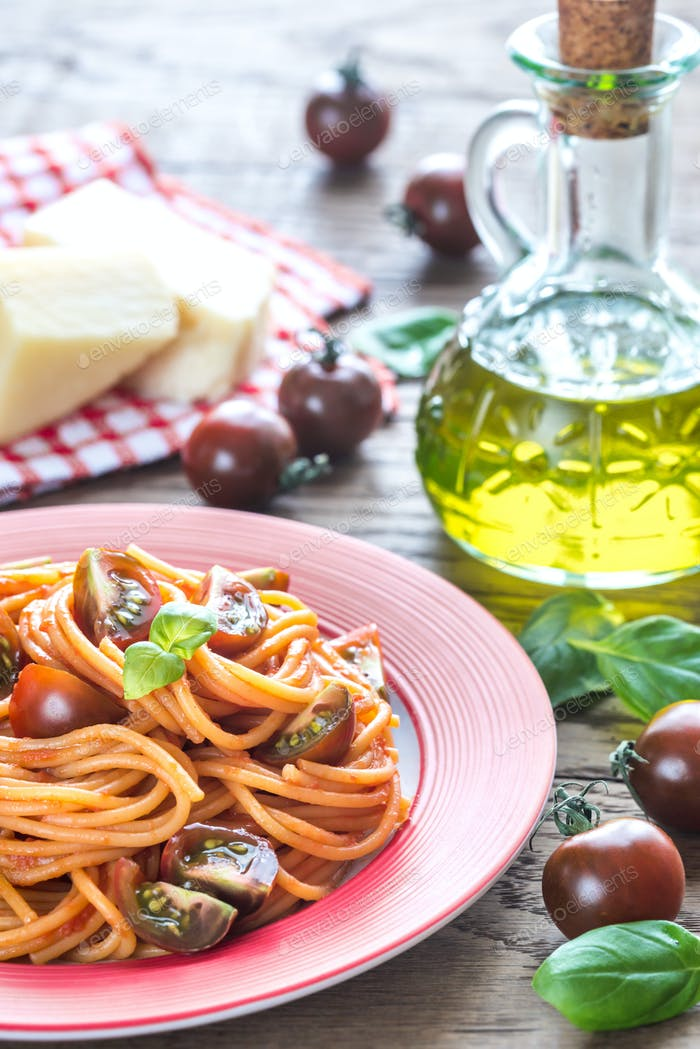 Portion of spaghetti with cherry tomatoes
