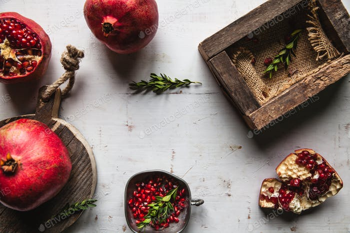 Pomegranate on an old, shabby white background, healthy food, fruit, vintage