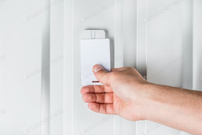person opening door with electronic card, home security concept