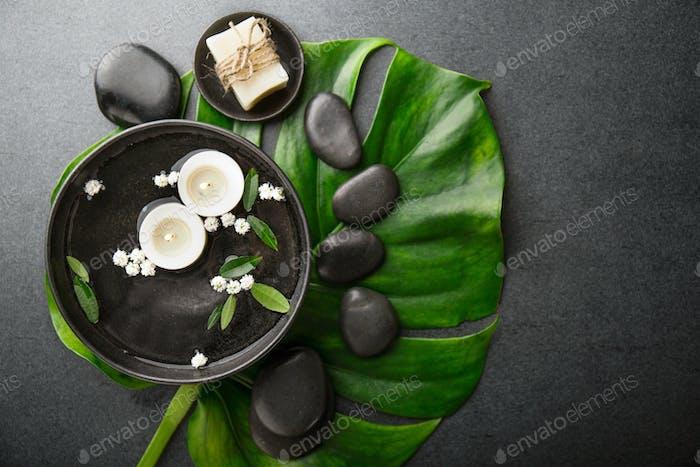 Spa accessories on dark background