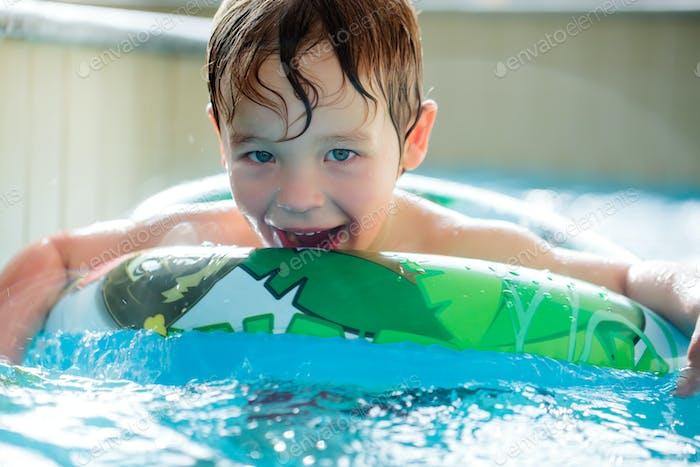 Boy in inflatable ring having fun