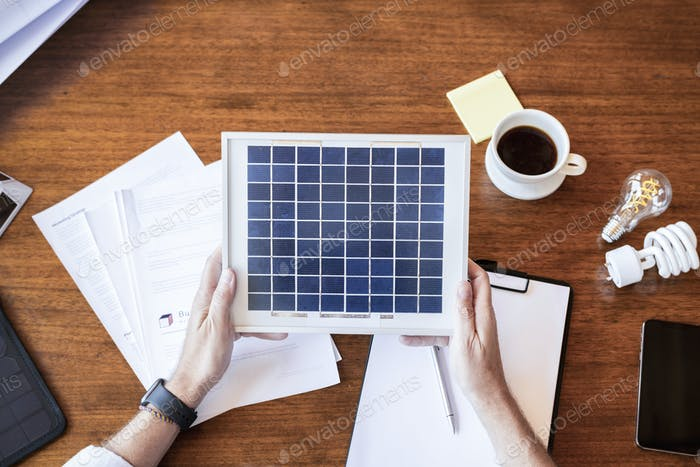 Man holding a solar panel sample