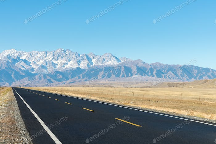 asphalt road on wilderness, highway to the grand canyon, xinjiang