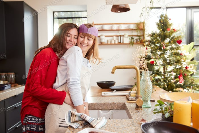Gay Female Couple At Home In Kitchen Washing Up After Dinner On Christmas Day