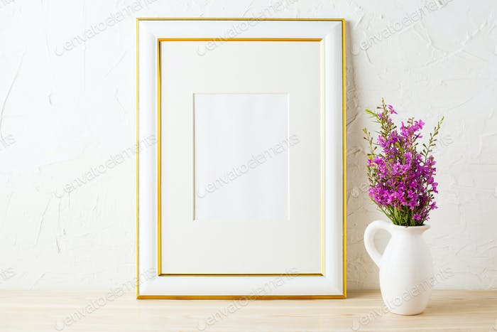 Gold decorated frame mockup and purple wildflowers in pitcher