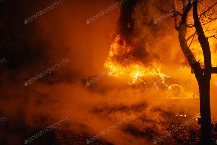 Burning car accident at night
