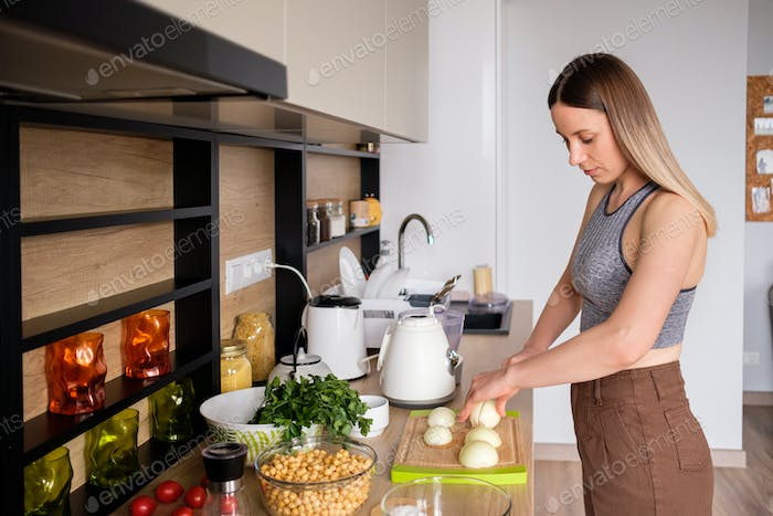 Beautiful woman cooking in modern kitchen