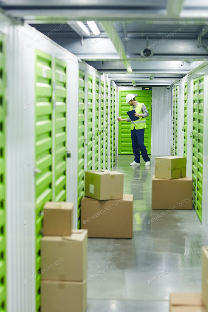 Man working with parcels in warehouse