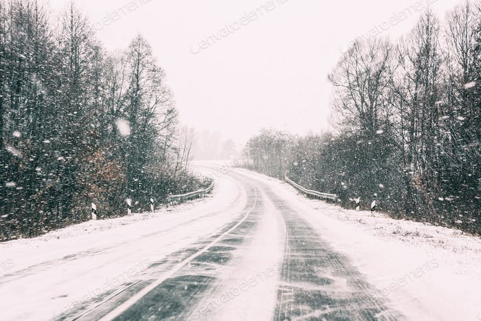Snow-covered Open Road During A Winter Snowstorm. Adverse Weathe