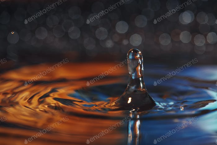Water drop and splash close up