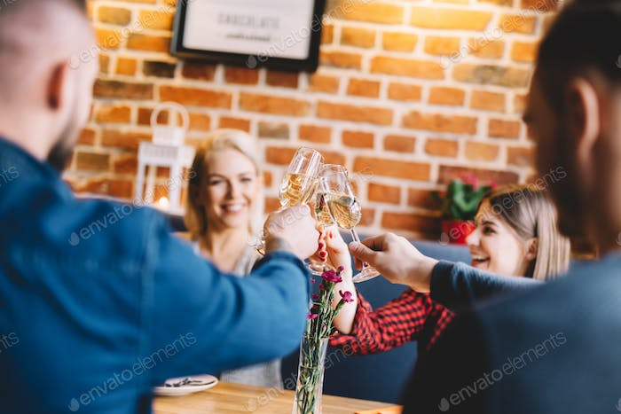 Young people toasting and laughing.