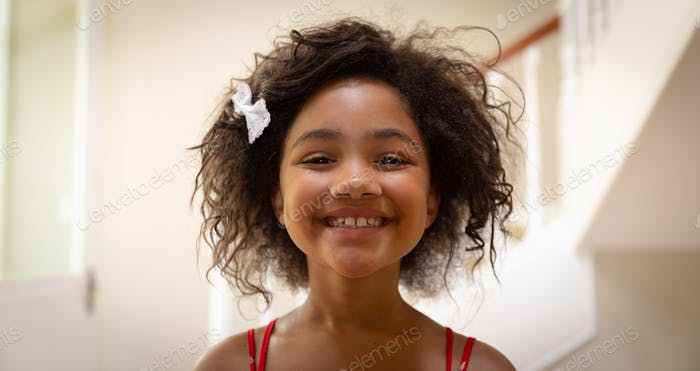 Young mixed race girl smiling to camera