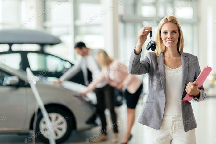 Professional salesperson in car dealership