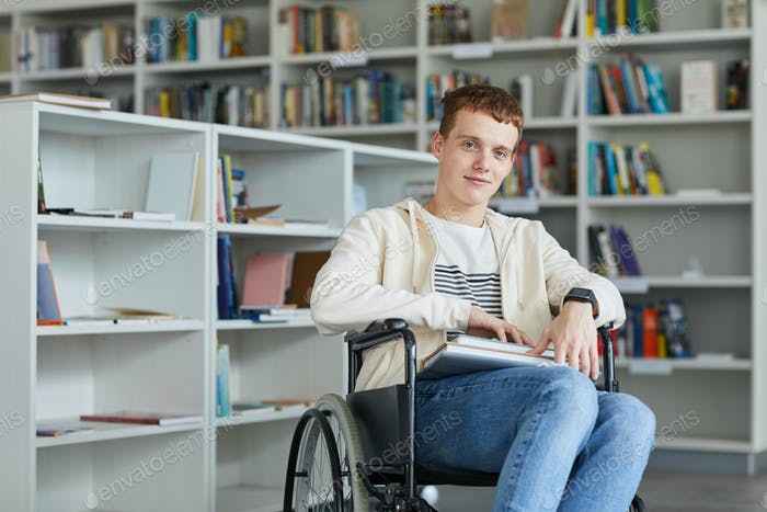 Portrait of Wheelchair User in College Library