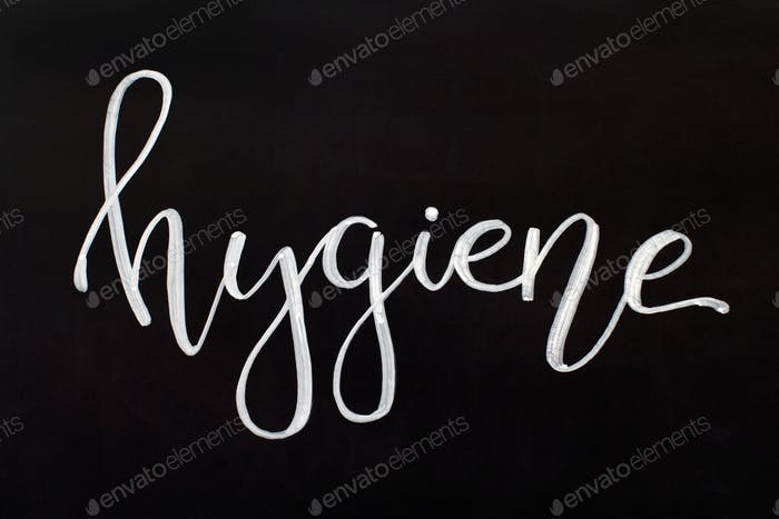Chalk inscription HYGIENE on a black chalkboard