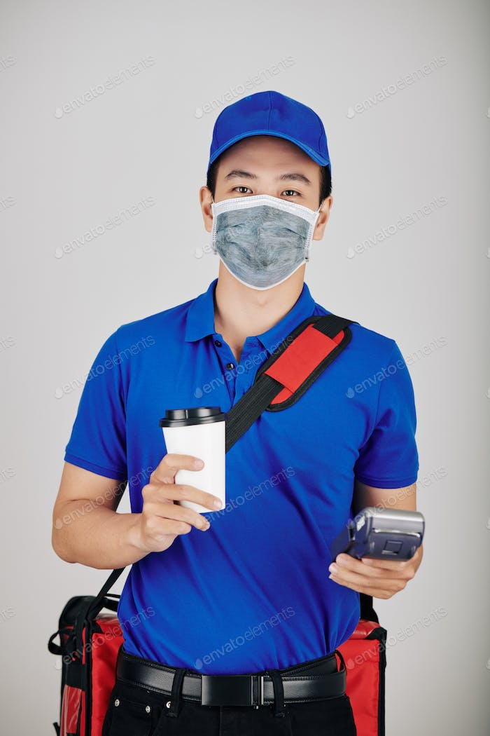 Cheerful courier with cup of coffee
