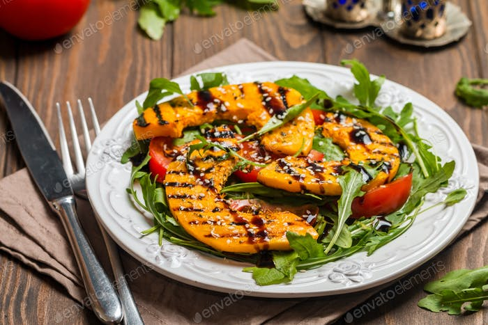 Delicious grilled pumpkin and arugula salad