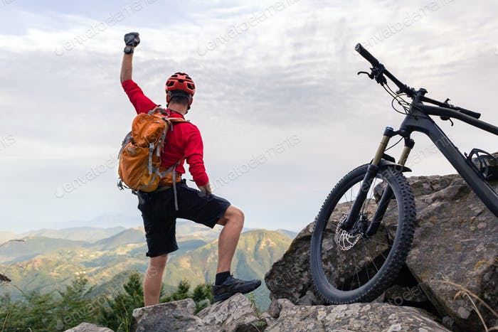 Mountain biker success, looking at inspiring mountains
