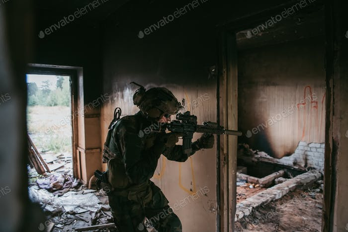 Soldier in full US MARSOC equipment entering abandoned building, aiming different angles with MK18