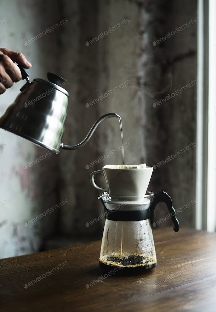 Barista hand dripping brewed coffee