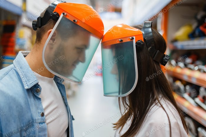 Couple choosing equipment in hardware store