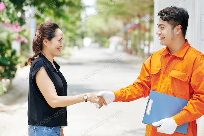 Moving Man And Client Shaking Hands