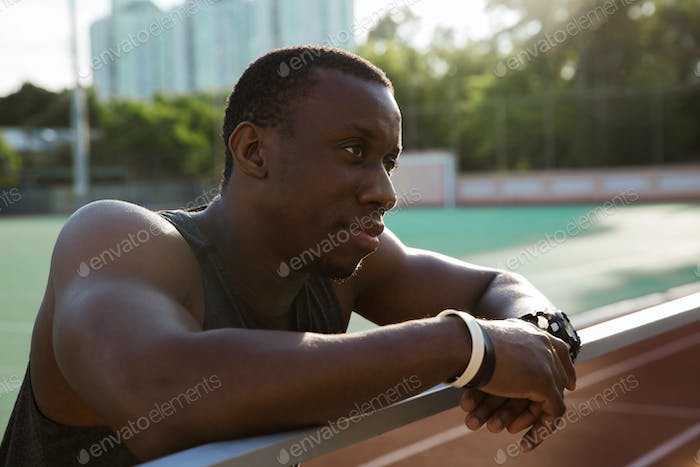 Close up of a african sportsman leaning on the railing
