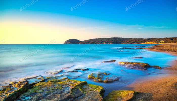 Baratti beach bay, headland hill, rocks and sea on sunset. Marem