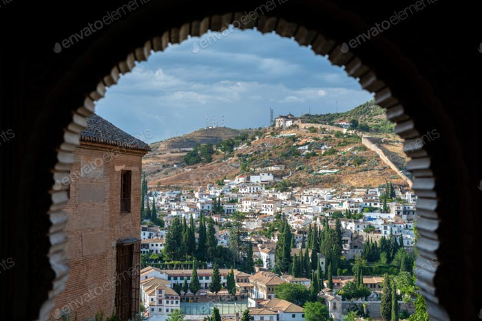 Alhambra arch and Granada cityscape