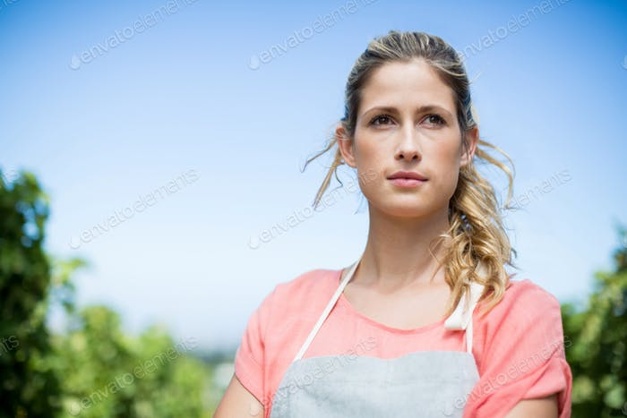 Thoughtful female farmer at vineyard
