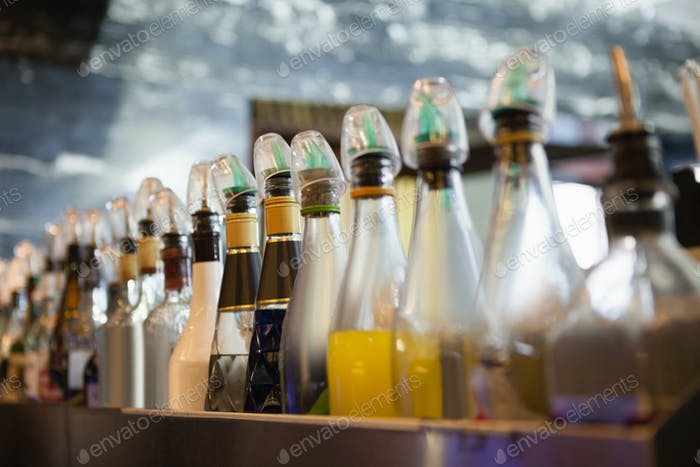 Close up of several bottle in a line at the nightclub