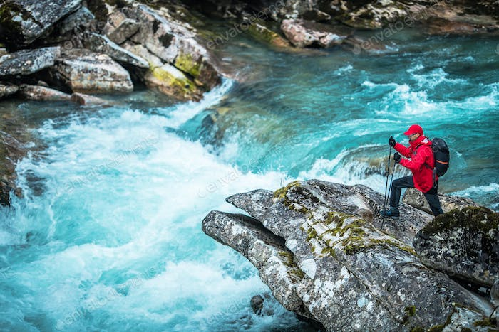 Hiker and the Glacial River