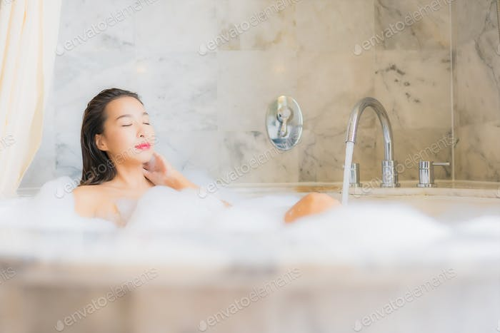 Portrait beautiful young asian woman relax take a bath