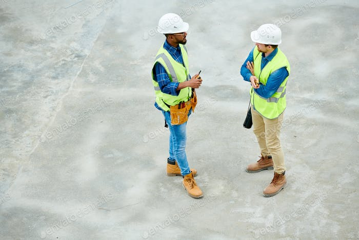 Engineers speaking on construction site