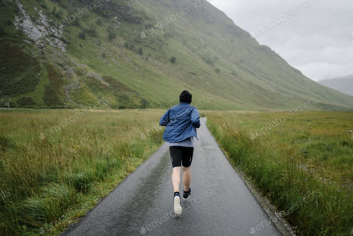 Man jogging through the Highlands